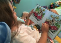 preschooler reading on her own
