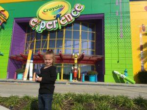 Kindergartner standing in front of The Crayola Experience Orlando
