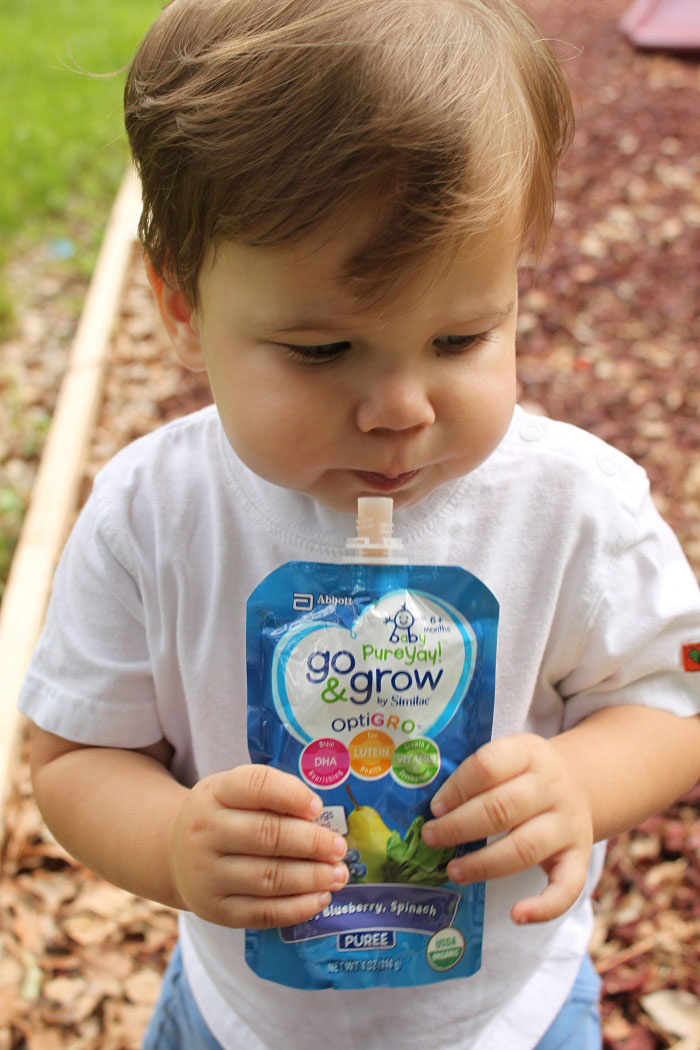 When my toddler is a picky eater, sometimes it's a self feeding battle. Here he's feeding himself a Go & Grow by Similac pouch. | www.sahmplus.com